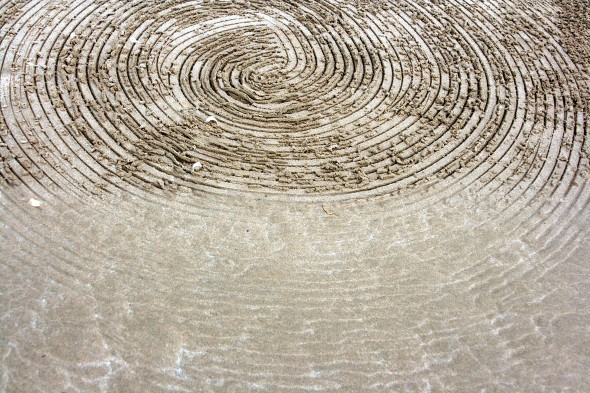 "Strijdom van der Merwe's ""Circles deposited by the tide"" erased by the first wave. Photo: Erica Lüttich."