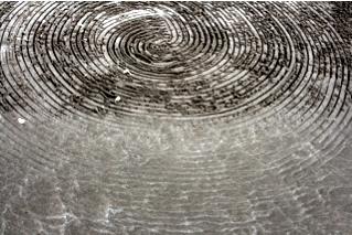 Tidal circles by Strijdom van der Merwe erased by wave. Photo: Erica Lüttich
