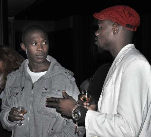 "Invited artist Blessing Ngobeni (right) in conversation with one of the guests at the Circa launch. Blessing expressed his enthusiasm for the project saying, ""Land art is new to me, I'm actually a serialist painter, but I am looking forward to the challenge. I am going to bring out all my spears and energy for this one. It's an opportunity for me to show that I can make a success of anything that comes my way. I can't wait."""