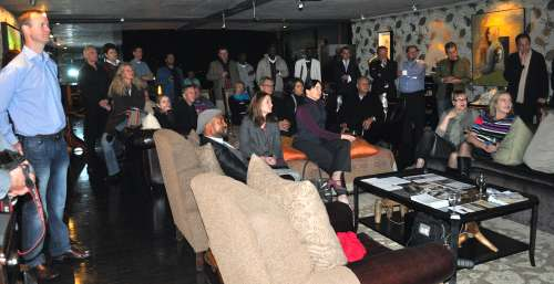 Guests at the launch watch Daron Chatz's promotional Site_Specific video showcasing some of the 2011 land art works and artists. Introductions, presentations, and speeches were made by the Mayor of Plettenberg Bay, Memory Booysen, Strijdom van der Merwe, Anni Snyman, Peter Bruce of Business Day and Financial Times, Reinhard Visser of the Beacon Island resort, and master of ceremonies Heather Greig.